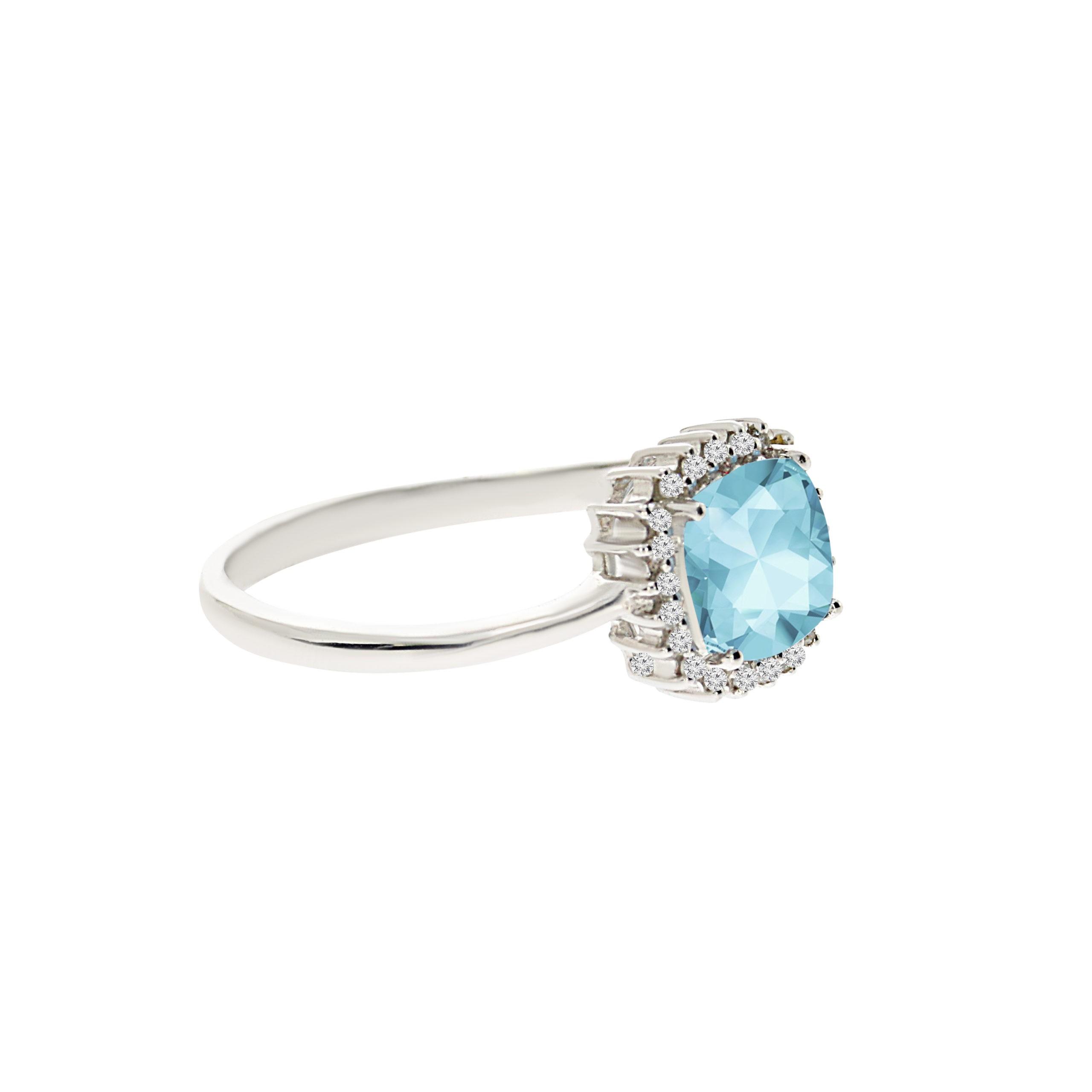 טבעת בלו טופז 1 קראט, זהב-לבן 14 קראט, בשיבוץ 0.07 קראט יהלומים