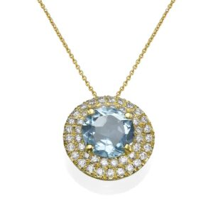 Diamonds Necklace and a blue Topaz gemstone set with a 14 karat yellow Gold Pendant