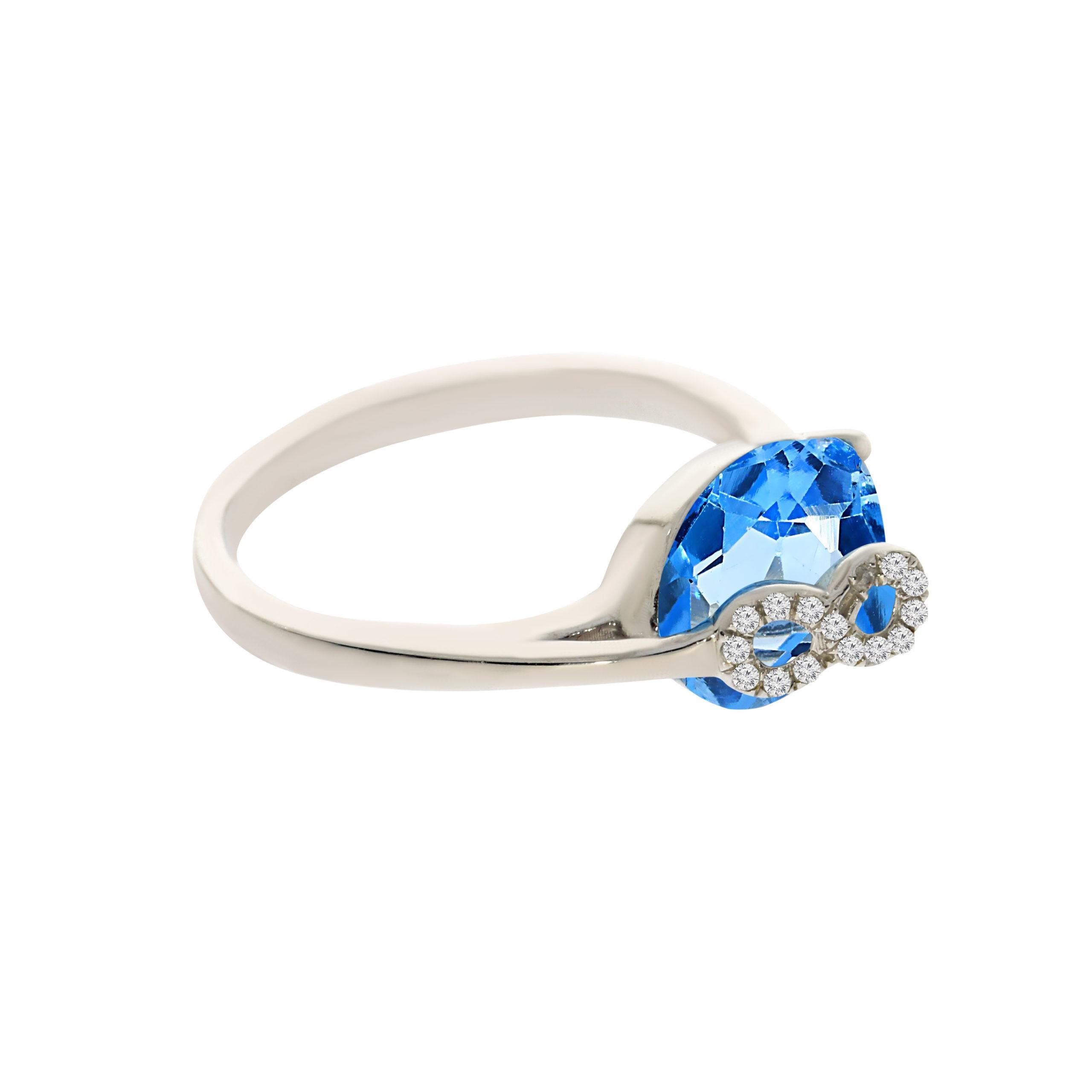 טבעת בלו טופז 3.29 קראט, זהב-לבן 14 קראט, בשיבוץ 0.03 קראט  יהלומים
