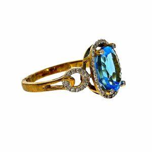 טבעת בלו טופז 3.29 קראט, זהב-צהוב 14 קראט, בשיבוץ 0.20 קראט יהלומים