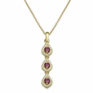 A Necklace of Diamonds and Rhodolite gemstones set with a 14 karat yellow Gold Pendant