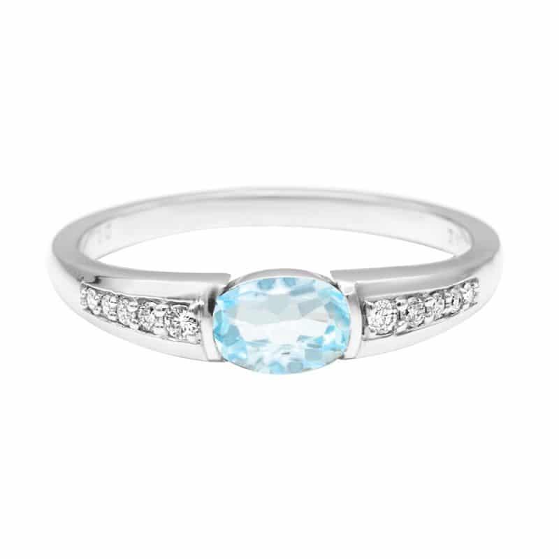 טבעת טופז-כחול 0.53 קראט, זהב-לבן 14 קראט, משובצת יהלומים